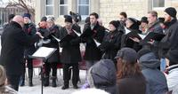 Choir singing at dedication of Memorial Bench