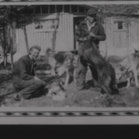 AB and AL Karras in front of cabin with dogs