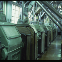 [Row of machinery within a flour mill]