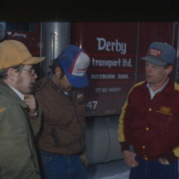 Allan Katona, left, Derby truck driver Larry Simon and Kelly Stevens, Corning
