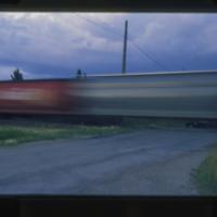 [Train at crossing]