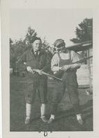 [Two men holding guns]