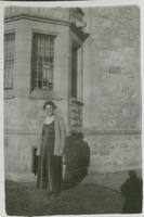 [Woman standing on campus]