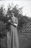 [Woman holding small dog]