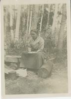 [Woman in camp eating meal]