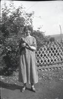 [Woman holding cat]