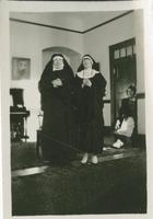 [Two women dressed in nun's habits]